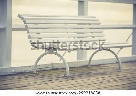 Stylish bench in summer park - stock photo