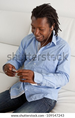 Stylish black man with a smart phone.