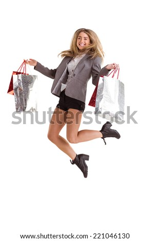 Stylish blonde jumping with shopping bags on white background - stock photo