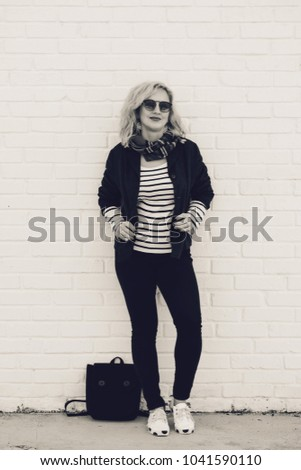stylish blonde woman outdoors in fall time