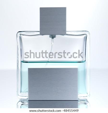 Stylish bottle of French perfume - stock photo