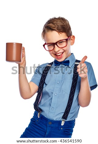 Stylish boy in glasses holding cup of tea, coffee or juice. He is smiling and looking into the camera. Isolated on a white background. - stock photo