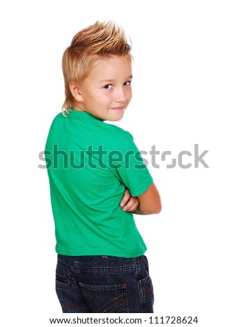 Stylish boy in green top looking back  on white background - stock photo