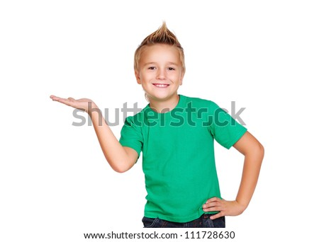 Stylish boy in green top on white background making a presenting gesture - stock photo