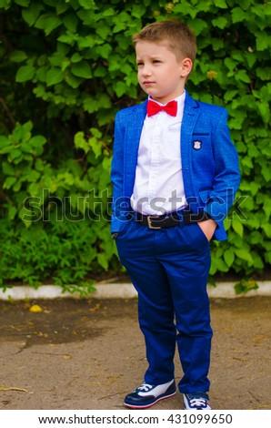 stylish boy in suit - stock photo