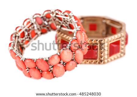 Stylish bracelets isolated on white background.