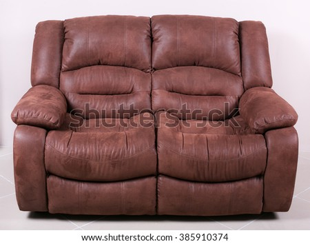Stylish brown suede sofa on a white background - stock photo