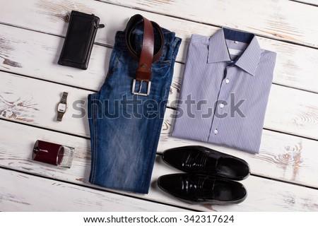 Stylish business clothing. Men's clothing on a wooden background. - stock photo