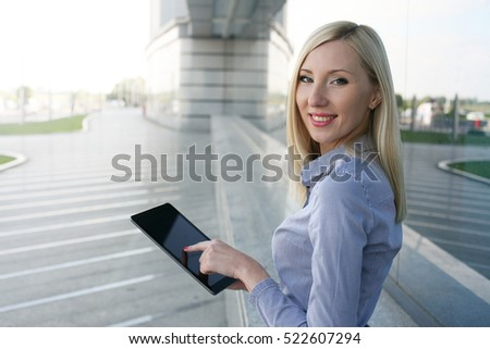 Stylish business woman working on a tablet PC.