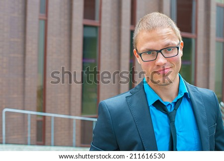 Stylish businessman in eyeglasses. Place fot your text. - stock photo