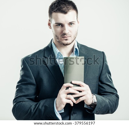 stylish businessman portrait with booklet