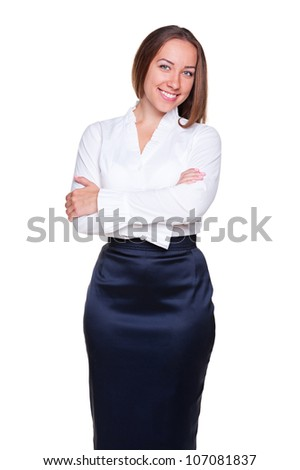 stylish businesswoman with crossed hands posing over white background. studio shot