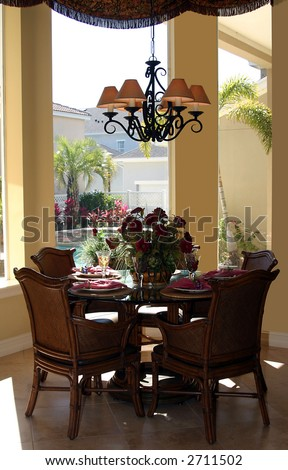 Stylish Casual Dining Table With Place Settings In Upscale Home