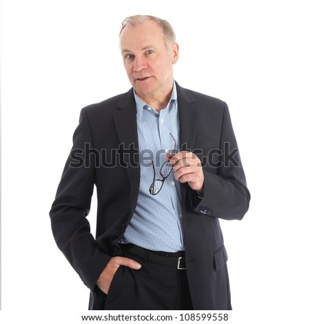 Stylish charismatic businessman Stylish charismatic middle-aged businessman standing listening with his glasses in his hand isolated on white