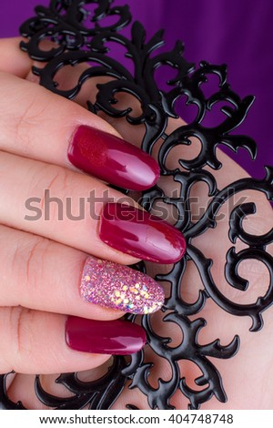 Stylish Colorful Nails and nail polish on a bright background. Manicure nail painting. Beauty hands.