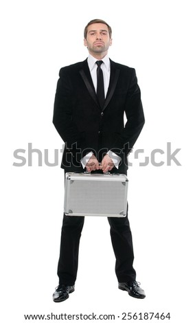 Stylish confident  businessman with metal suitcase. Full-length. Isolated over white background - stock photo
