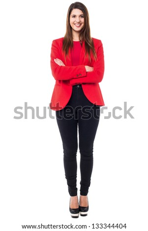 Stylish confident young businesswoman wearing bright red blazer. - stock photo