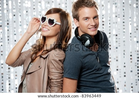 Stylish couple in a night club. - stock photo