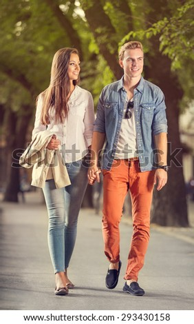 Stylish couple in love  walks in the park - stock photo