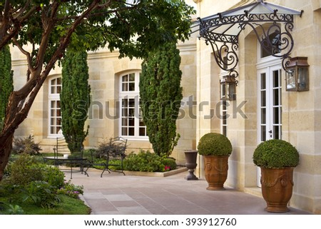 Stylish courtyard and facade of a French mansion in Aquitaine