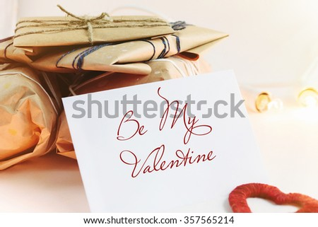 Stylish craft presents for special occasions, be my valentine's text, happy holiday greeting card concept