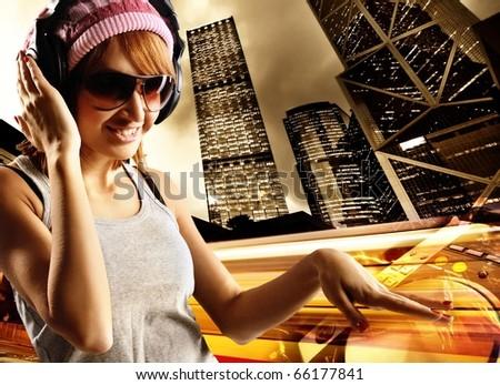 Stylish dancing girl against night city - stock photo