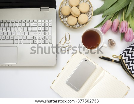 stylish desktop with notebook and laptop