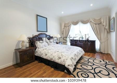 Stylish double bedroom - stock photo