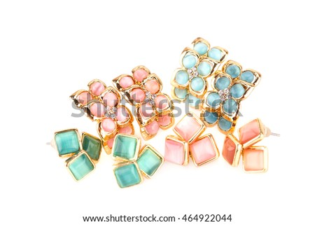 Stylish earrings with stones isolated on white background.