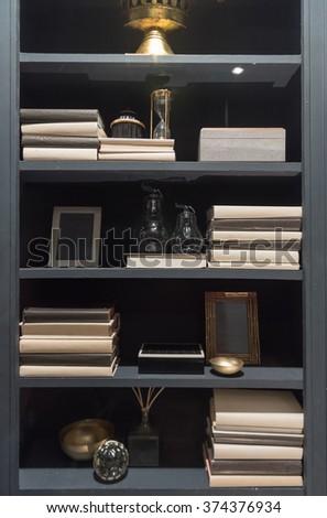 Stylish, Elegant and Modern Bookshelf with Books and Ornaments - stock photo
