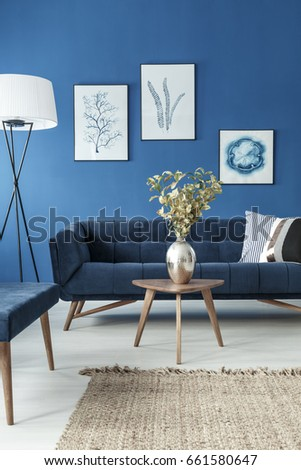 stylish end table with flower vase and vintage sofa in cyan living room - Cyan Living Room Decor