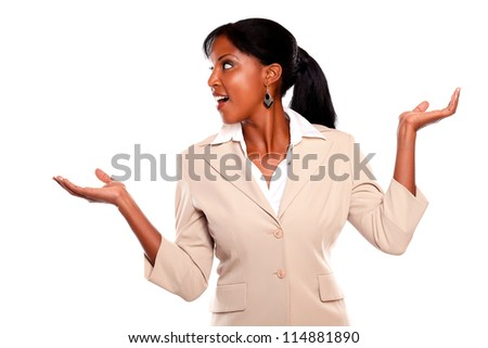 Stylish executive woman looking right with arms up on isolated background - stock photo