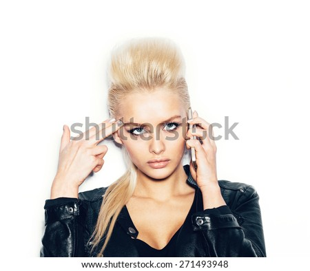 Stylish fashion blonde sexy young girl with phone in a black t-shirt gun shows.  White background, not isolated - stock photo