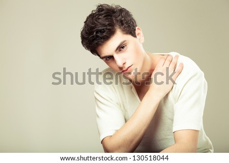 stylish fashion man model sitting on the chair - stock photo