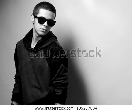 Stylish fashion young man portrait with sunglasses