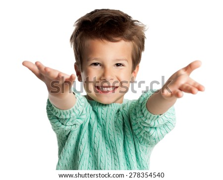 Stylish five year old European boy posing over white studio background. Boy with arms stretched out in welcome gesture. Enthusiastic looking child. - stock photo