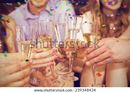 Stylish friends having a drink together against flying colours - stock photo