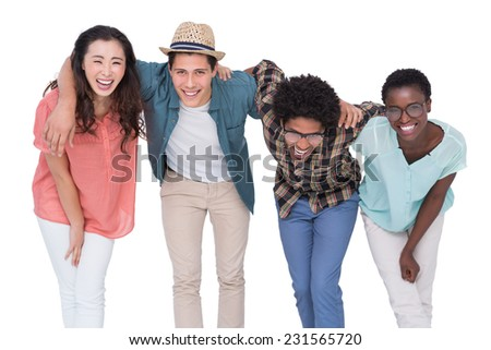 Stylish friends smiling at camera together on white background