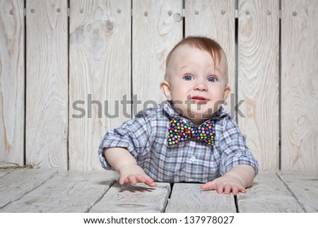 stylish funny little boy in bow tie