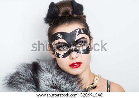Stylish girl in a mask Catwoman decorated natural grey black fur, red lips, small kitten ears, luxury jewelry. Perfect art idea for carnival Halloween party, animation team or dancer actress stripper - stock photo