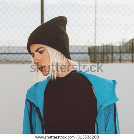 Stylish Girl in bright blue Coat and Hat. Urban style - stock photo