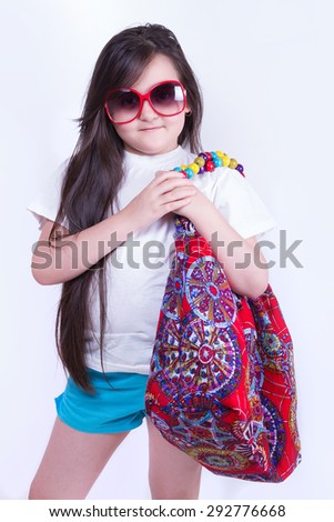 Stylish girl in shorts and a bag on his shoulder