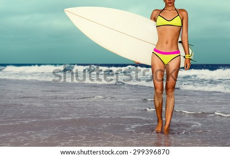 Stylish Girl on the beach with Surf board - stock photo