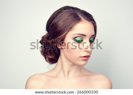 stylish glamor girl with beautiful hairstyle and bright makeup - stock photo