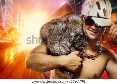 Stylish glamorous rapper in front of night city - stock photo