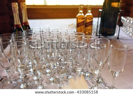 stylish glasses at alcohol bar table at luxury wedding reception, catering in restaurant - stock photo