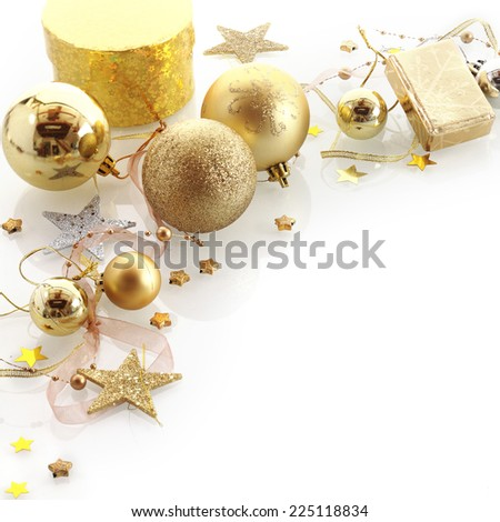 Stylish gold Christmas corner border with gifts, baubles, stars and ornaments over white with copyspace for your Xmas greeting