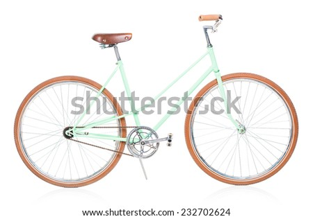 Stylish green female bike with brown wheels on white background - stock photo