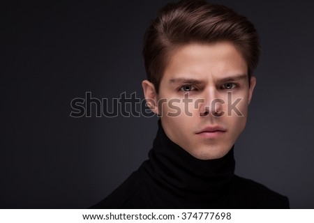 Stylish guy close up portrait on black background - stock photo