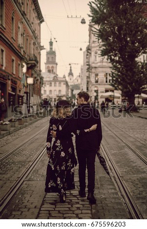 Image result for a man embracing woman and walking